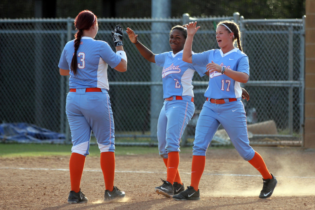 Angelina College's Shawneece Jones (2) and Kali Holcombe (17) greet teammate Kayla Boucher (13) after Boucher's double in the bottom of the eighth inning gave the Lady Roadrunners a 5-4, walk-off win over Bossier Parish Monday at Roadrunner Complex. The Lady Runners earned the sweep after blanking the Lady Cavs 7-0 in the opener. (AC Press photo)