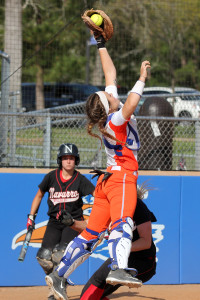 Angelina College catcher Heather Kulhanek makes a leaping grab of a throw home during Wednesday's doubleheader against Navarro College. The No. 10 Lady Roadrunners took a 6-4 win in the late game after dropping the opener by a 7-1 score. (AC Press photo)