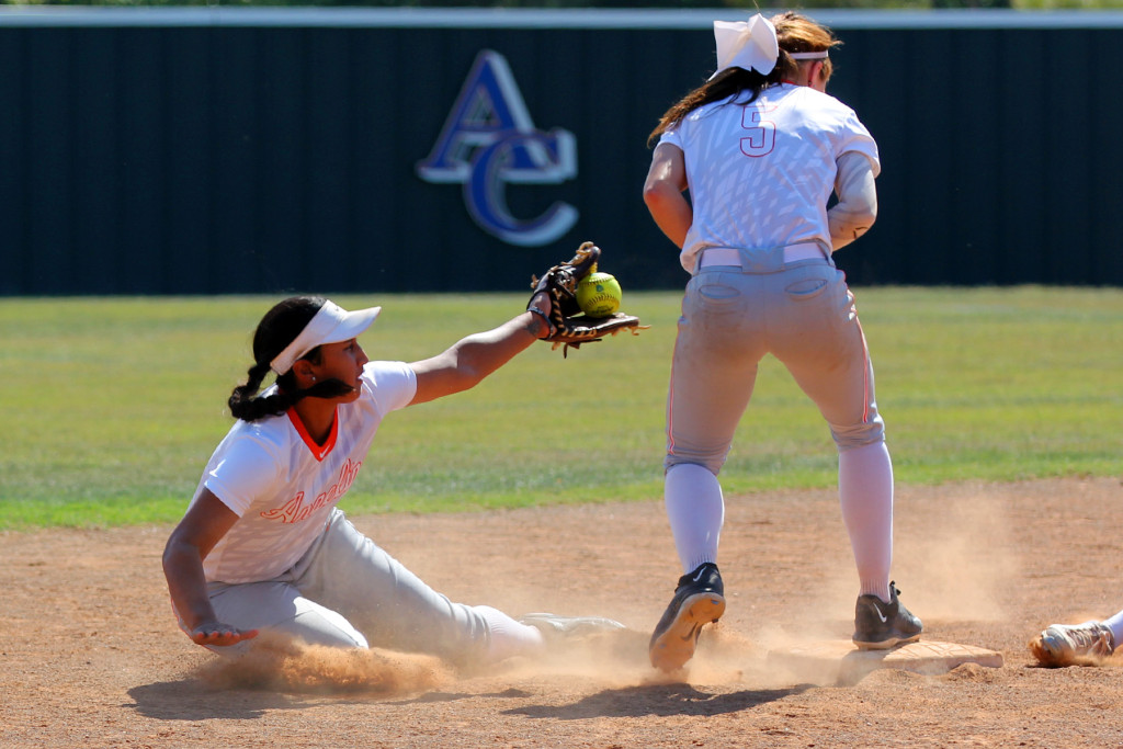 Angelina College second baseman Shay Vegas tries to scoop the ball to shortstop Bryli Lee during Monday's doubleheader against Trinity Valley College. The No. 15 Lady Roadrunners won the nightcap 4-2 after dropping the opener 1-0 at Roadrunner Complex. (Photo by AC News Service)