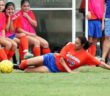 Angelina College's KK Reynoso tries a slide save in front of the Lady Roadrunner bench during Monday's match against Richland College in Dallas. The Lady Roadrunners dropped their debut 2-1 in extra time. (AC Press photo/Gary Stallard)