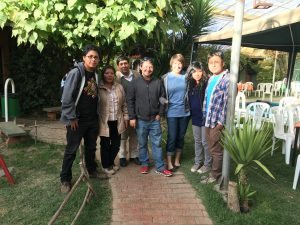 A photo of Chris Rudd, center, and his wife Miranda, right of him, and their host family in Bolivia.